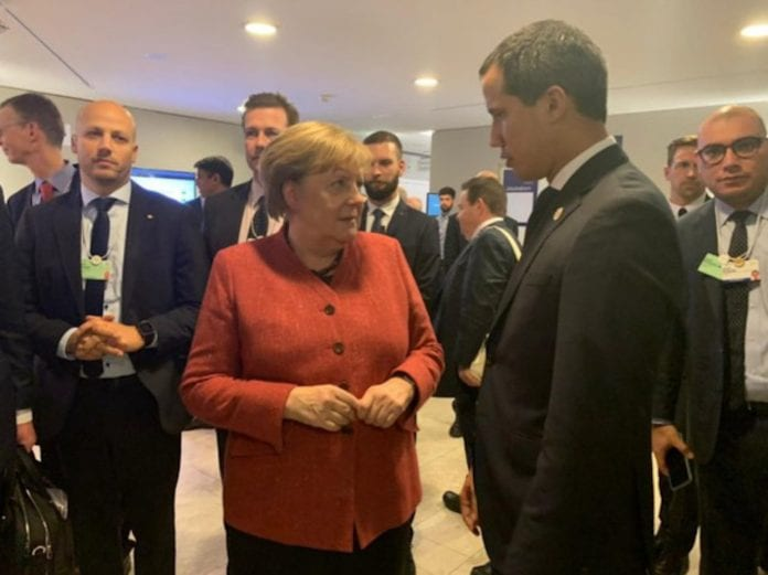 Merkel-guaidó-davos