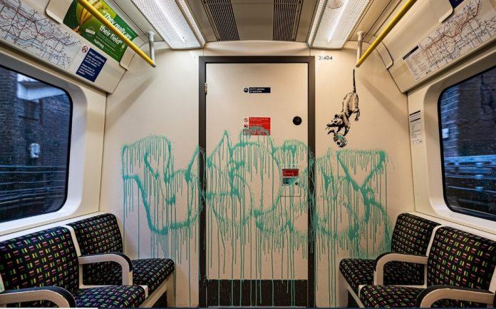 Banksy Londres metro mascarilla